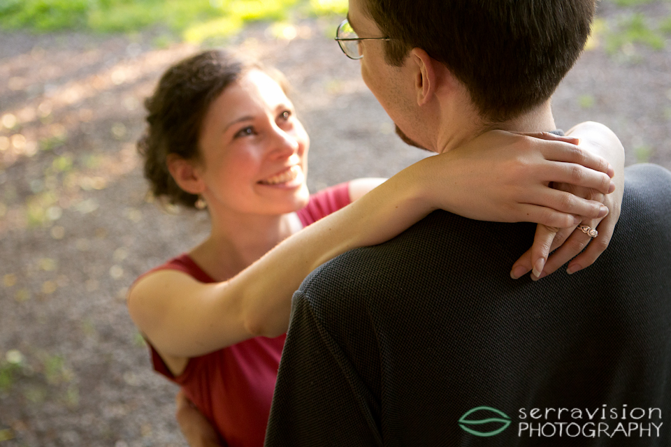 Happy couple - beautiful photo from portland engagement shoot - showing off the ring!
