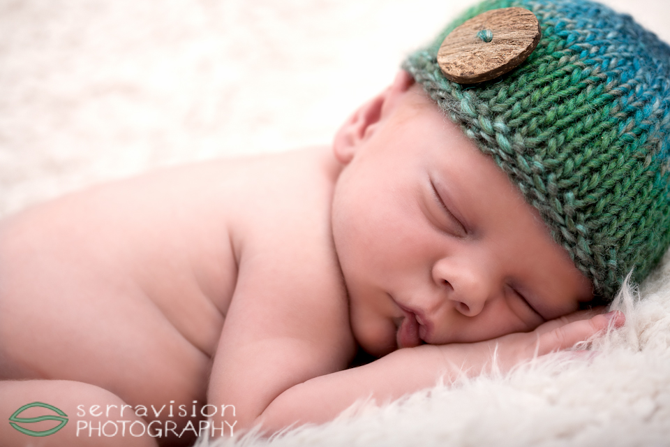 Newborn sleeping peacefully during his photo session
