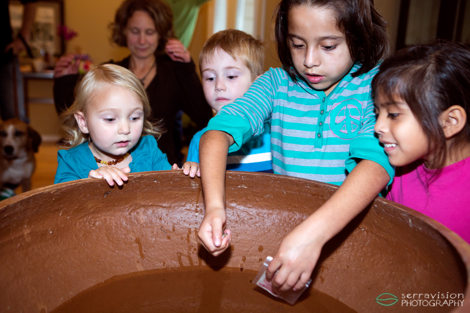 Children depositing tokens into the pool of life