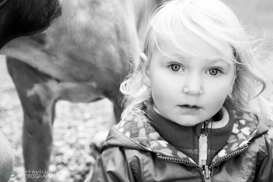 3-year-old girl's big, beautiful eyes shine in this picture in the park