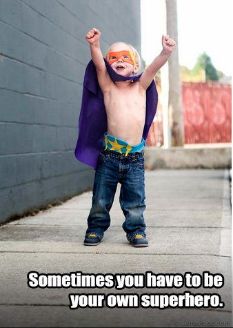 "Portrait of young child wearing a superhero costume that says ""Sometimes you have to be your own superhero"""