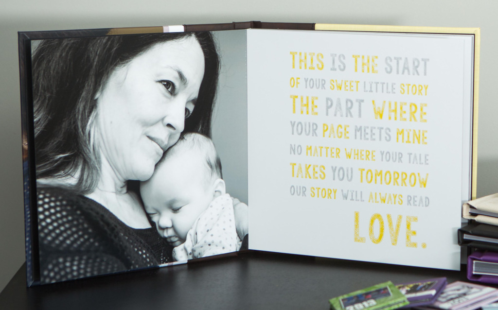 picture of a story based photo album celebrating the adoption of a baby girl